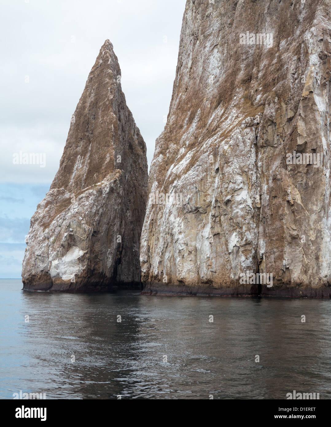 Sleeping Lion or Leon Dormida rock formation off coast of Galapagos islands - Stock Image