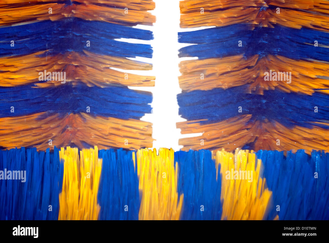 Close up of automatic car wash brushes. Blurred because of spinning brushes - Stock Image