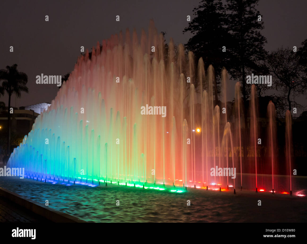 Illuminated fountains at dusk in Magic Water Tour / Circuit in Reserve Park, Lima, Peru - Stock Image