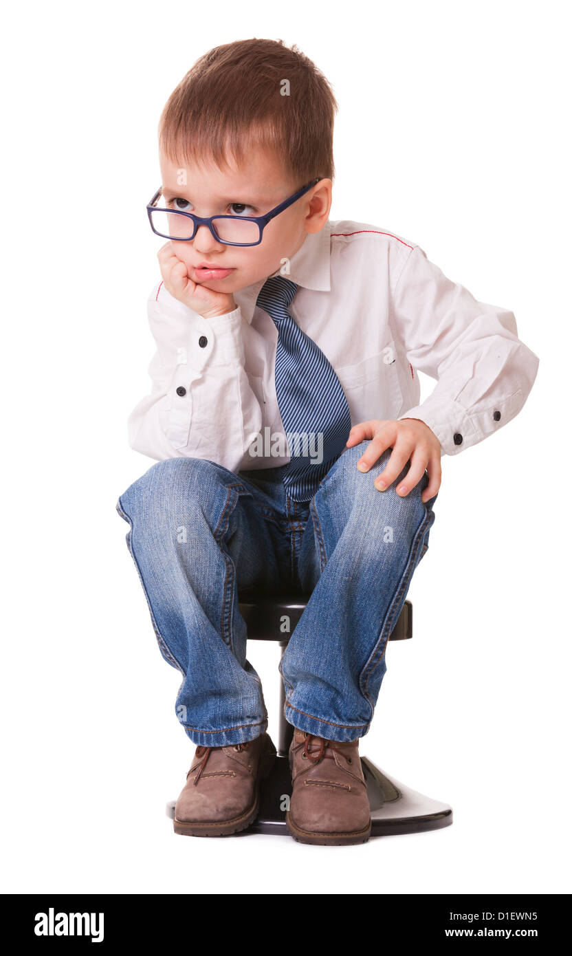 small child chair. Serious Clever Kid In Jeans And Shirt Sitting On Small Chair Isolated White Background - Child