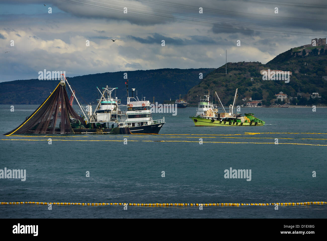 Purse Seine fishing boats on the Bosphorus Strait with Yoros Castle Turkey - Stock Image
