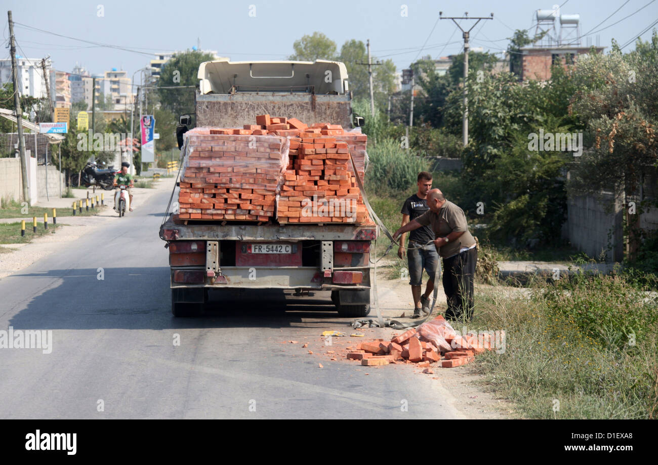 Lorry with an unsafe load of bricks in Albania - Stock Image