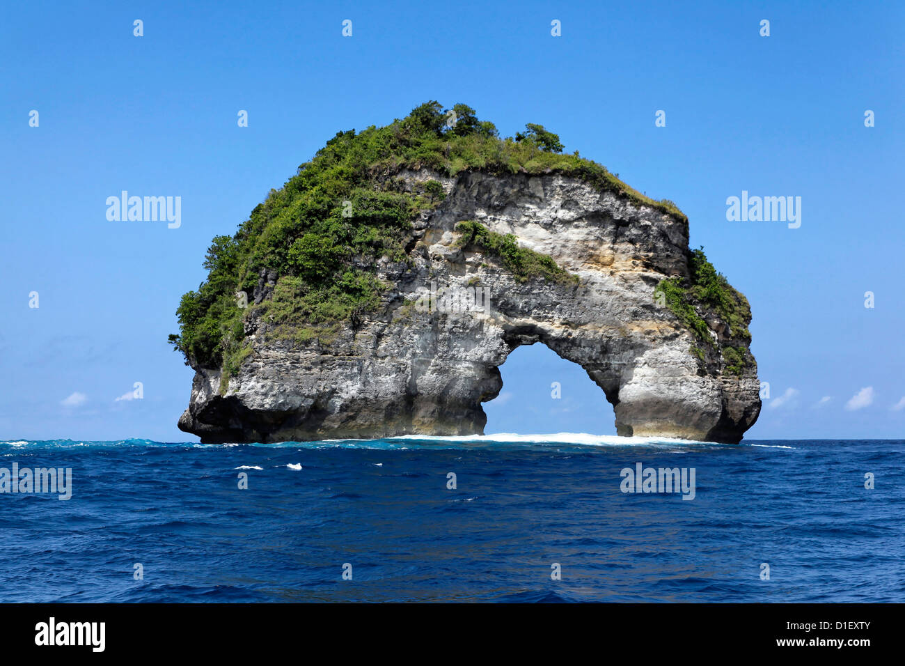 Rock arch above the water, Nusa Penida, Bali, Indonesia, Indian Ocean - Stock Image