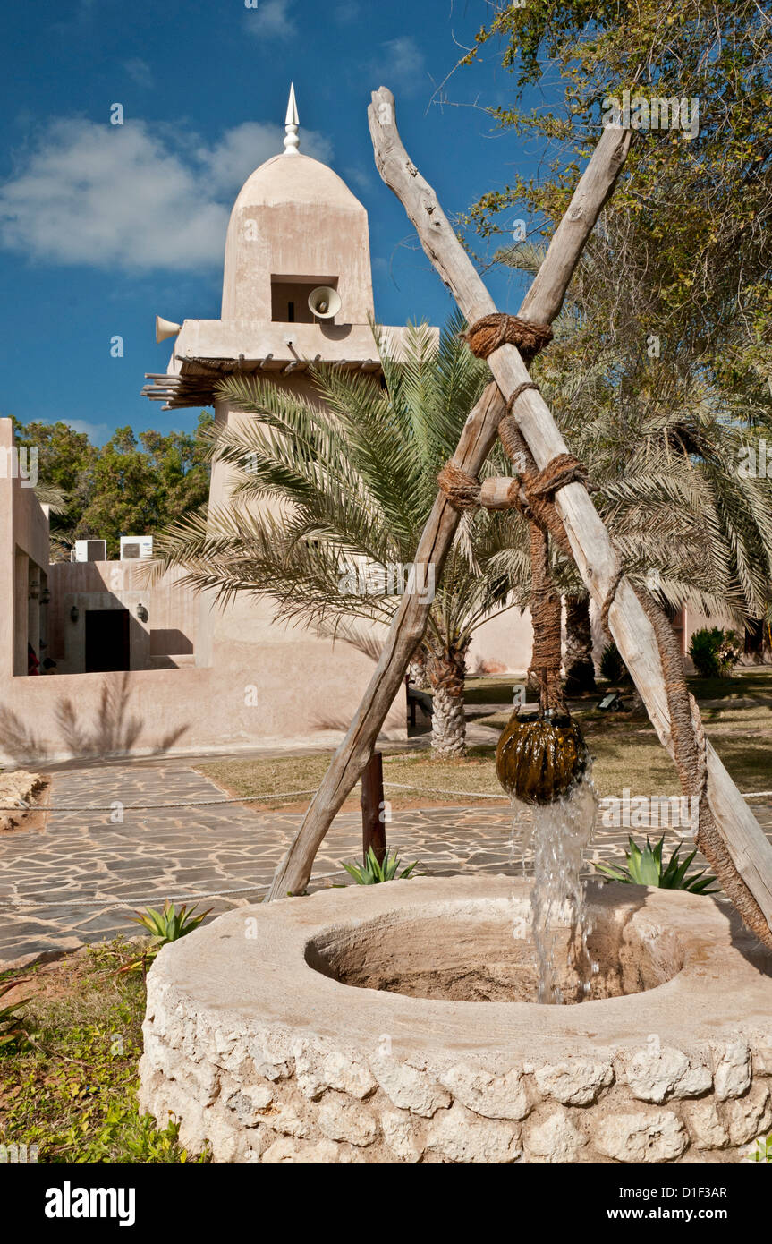 Historic well and mosque in an open-air museum, Abu Dhabi - Stock Image