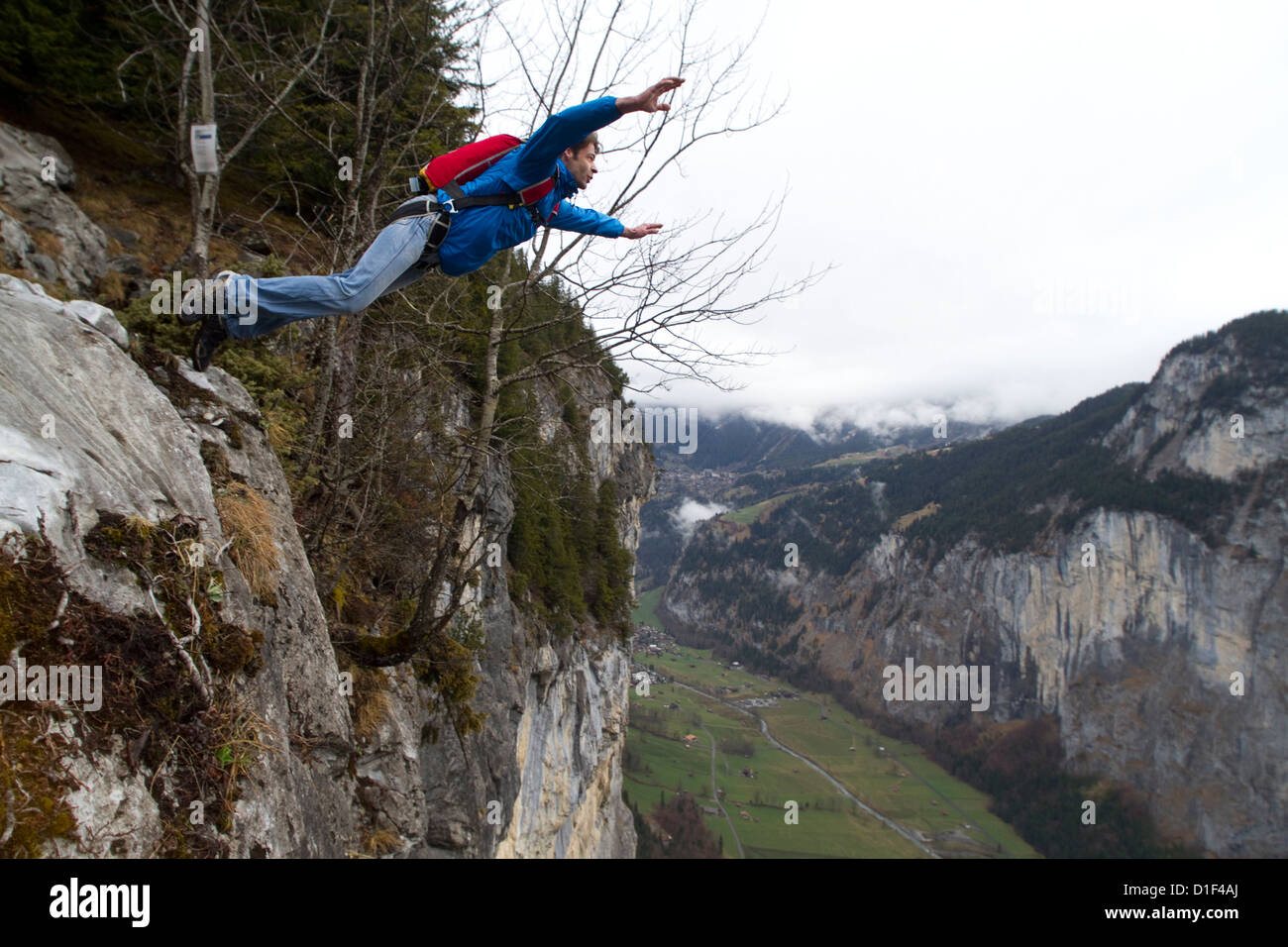 Basejumper jumping off, Bern, Switzerland - Stock Image