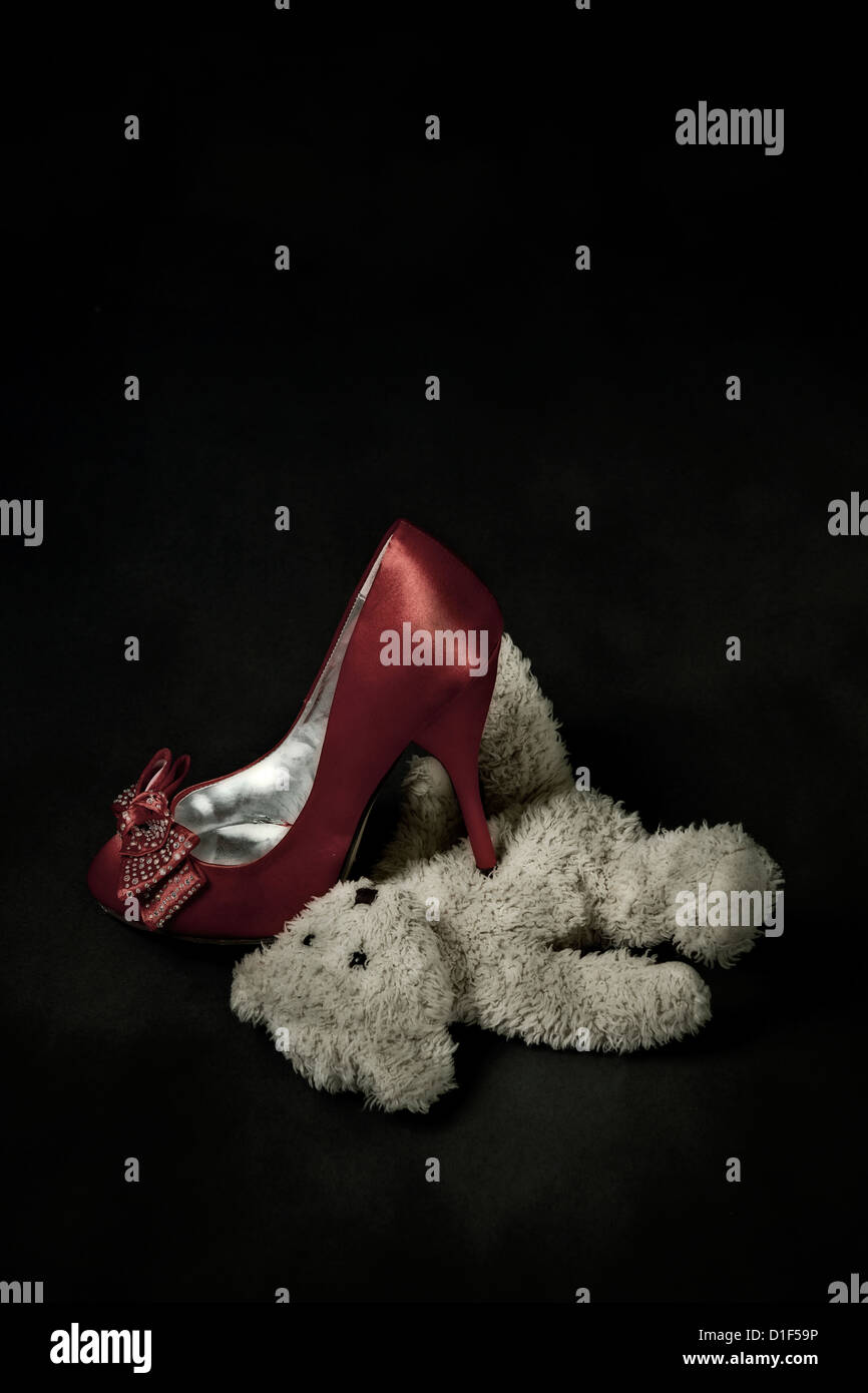 red shoe steps on a teddy bear Stock Photo