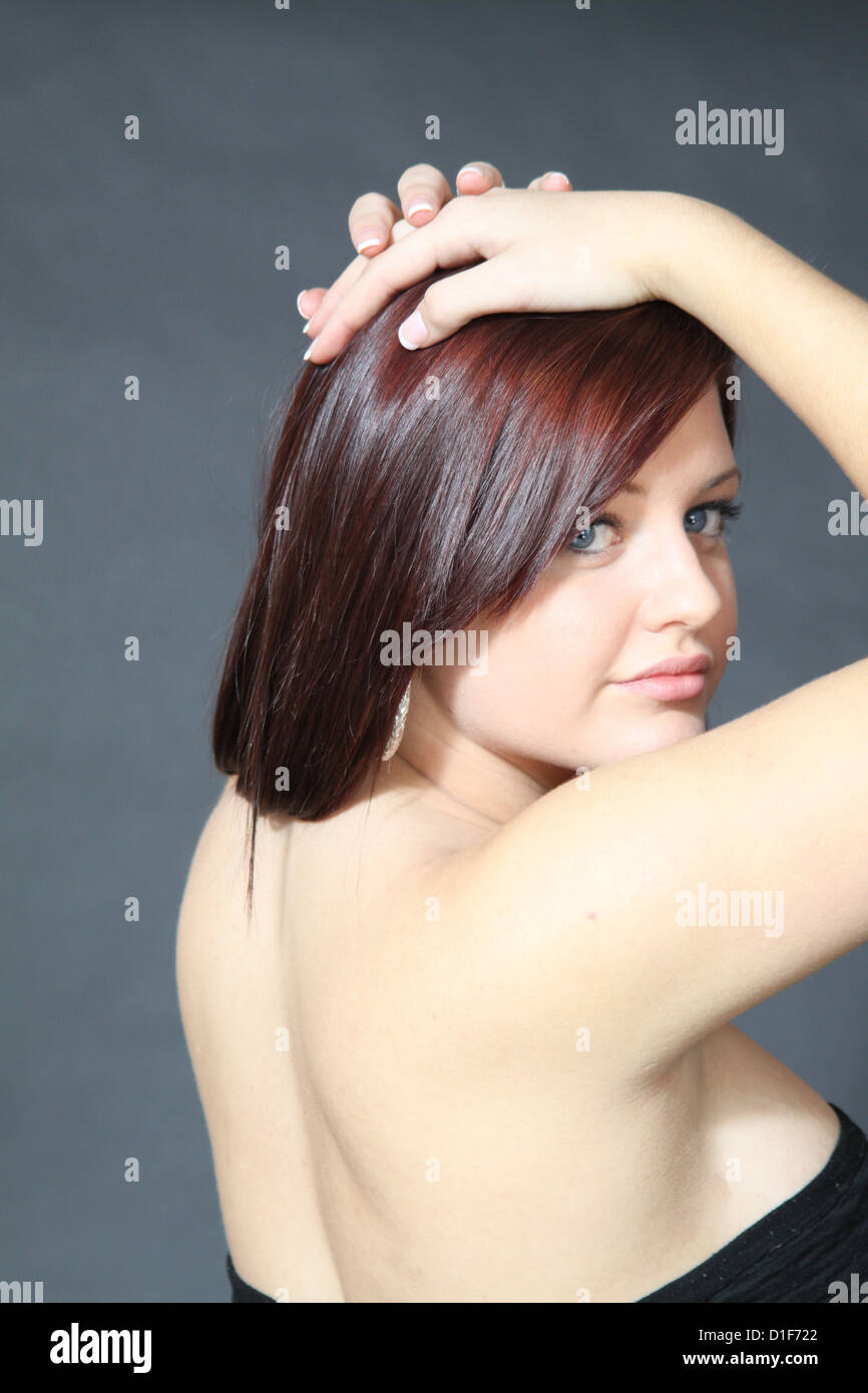 Beautiful Blue Eyed Teenager With Red Highlights In Her Hair