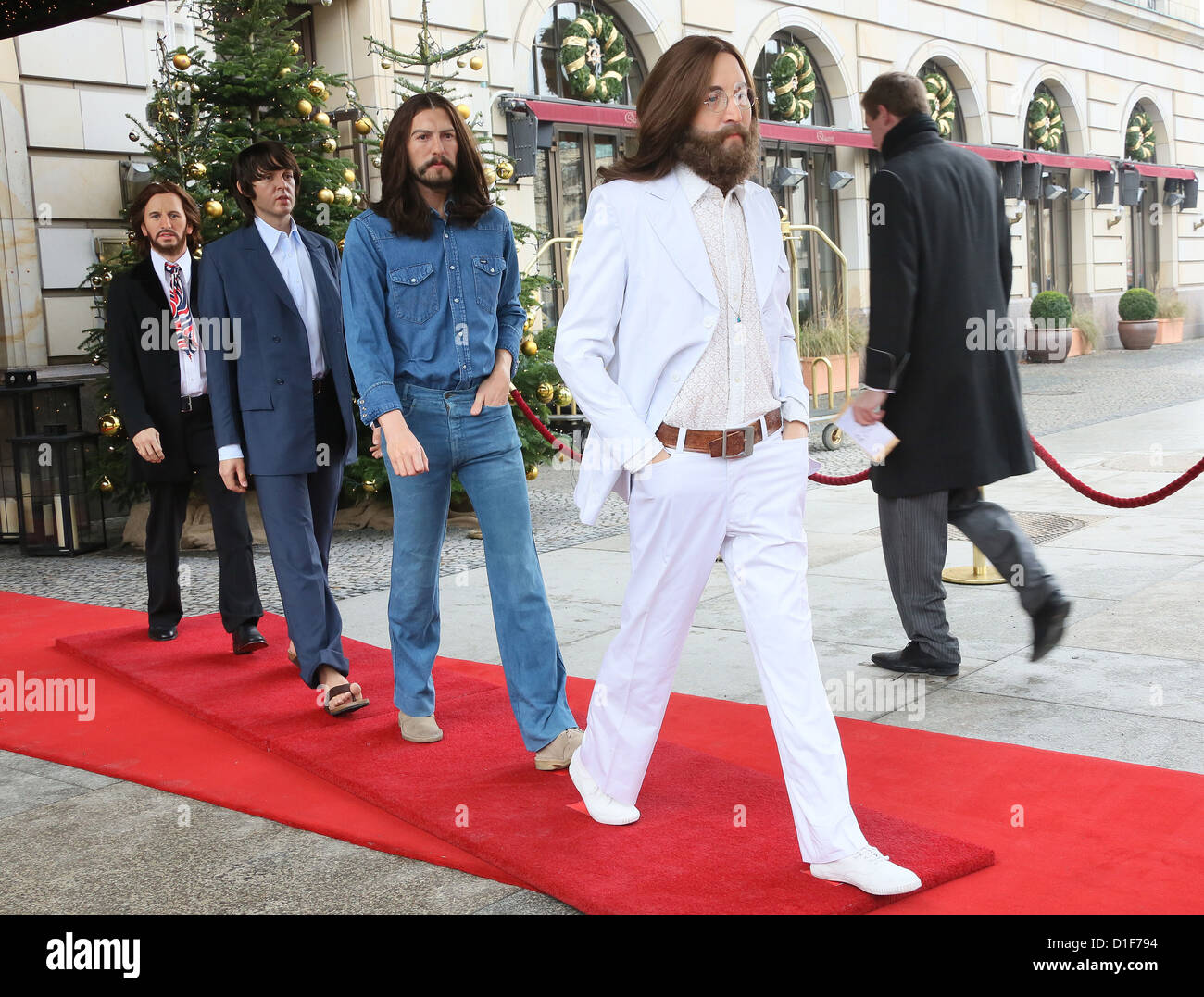 Wax figures of John Lennon (r-l), George Harrison, Paul McCartney and Ringo Starr as Abbey Road Beatles stands at - Stock Image