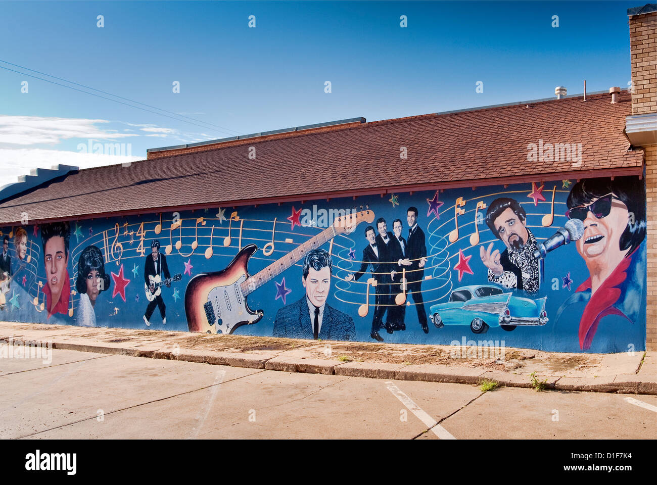 Elvis Presley, Buddy Holly, other 1950s rock'n'roll stars in mural in Clovis in Great Plains area of New - Stock Image