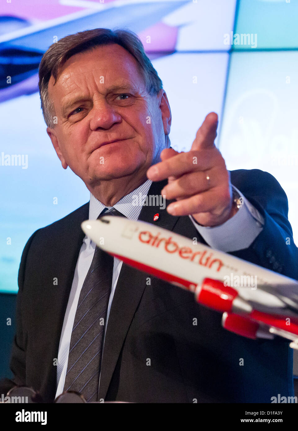 Hartmut Mehdorn, head of the Air Berlin board and James Hogan, poses with a miniature plane during a press conference - Stock Image