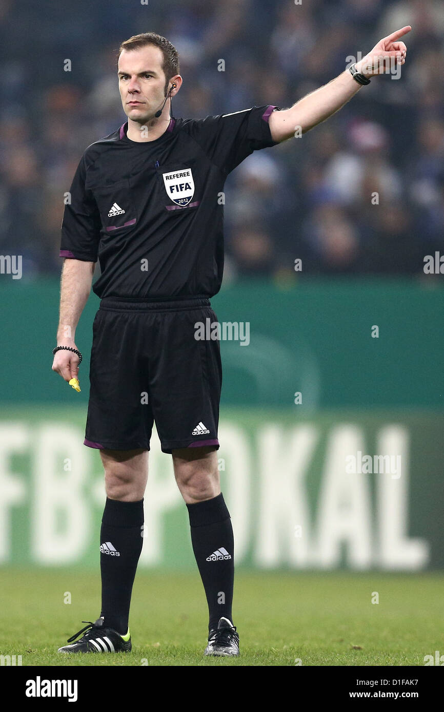 Referee Marco Fritz gestures during the DFB cup round of sixteen match between FC Schalke 04 and 1. FSV Mainz 05 - Stock Image