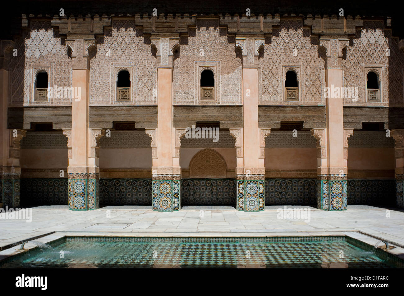 A tiled interior courtyard and reflecting pool at the Ben Youssef Madrassa, Marrakech, Morocco, North Africa, Africa - Stock Image