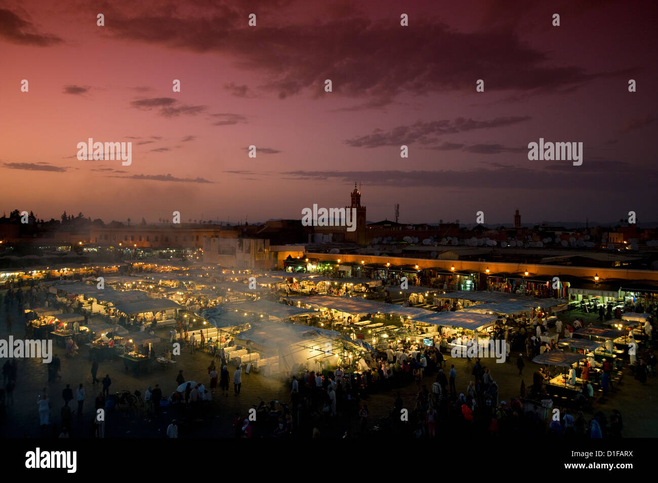 Food stalls at dusk in the main square, Jemaa el Fna in Marrakech, Morocco, North Africa, Africa - Stock Image