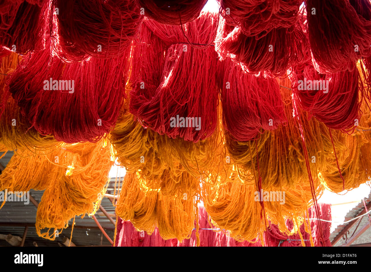 Brightly coloured wool hanging to dry in the dyers souk, Marrakech, Morocco, North Africa, Africa - Stock Image