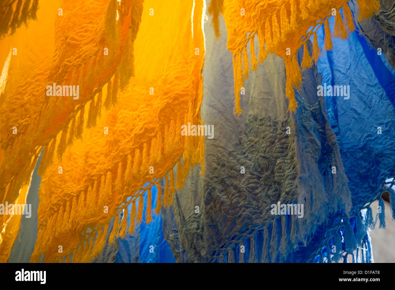 Brightly coloured dyed fabrics hanging to dry in the dyers souk, Marrakech, Morocco, North Africa, Africa - Stock Image