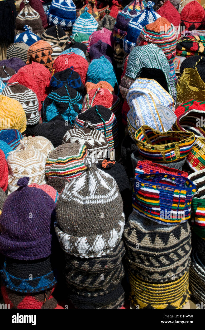 Brightly coloured knitted wool hats for sale in the souk in Marrakech, Morocco, North Africa, Africa Stock Photo