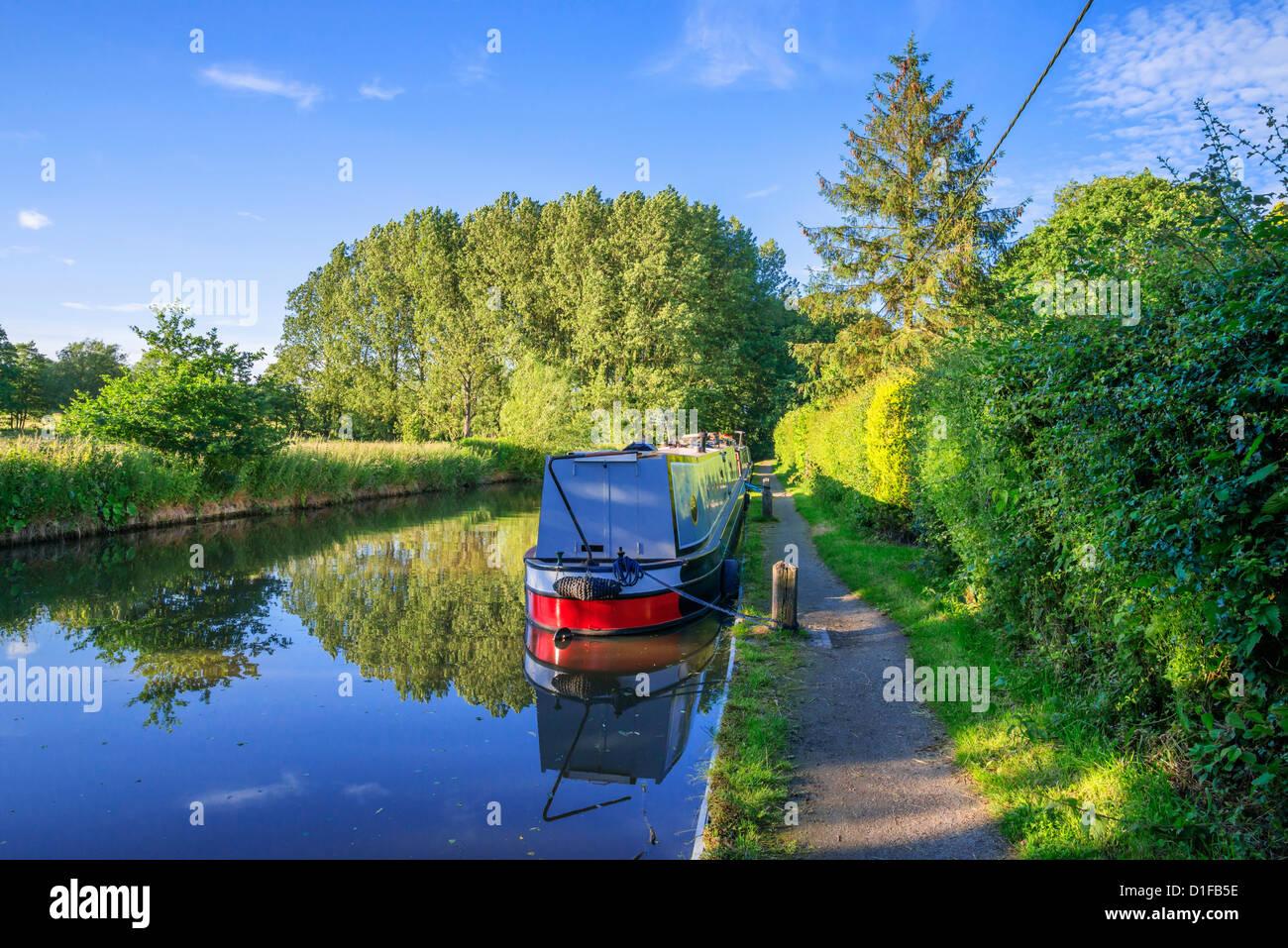 A narrow boat on the Stratford upon Avon canal, Preston Bagot flight of locks, Warwickshire, Midlands, England, - Stock Image