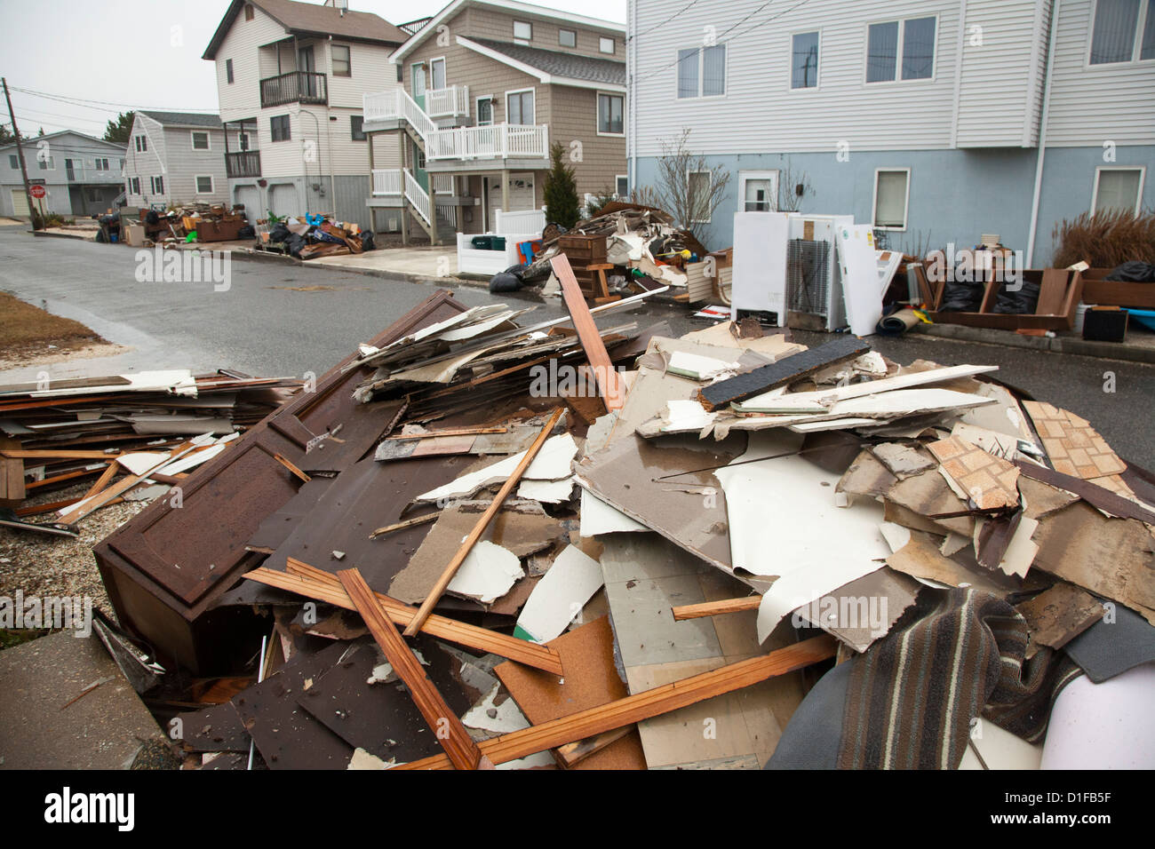 Debris from Hurricane Sandy lines the streets on Long Beach Island, a barrier island off the New Jersey coast. - Stock Image
