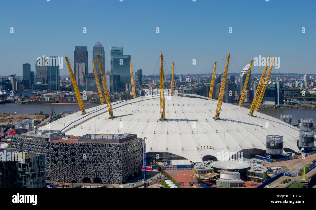 The O2 Arena in Greenwich with Canary Wharf behind, Docklands, London, England, United Kingdom, Europe - Stock Image
