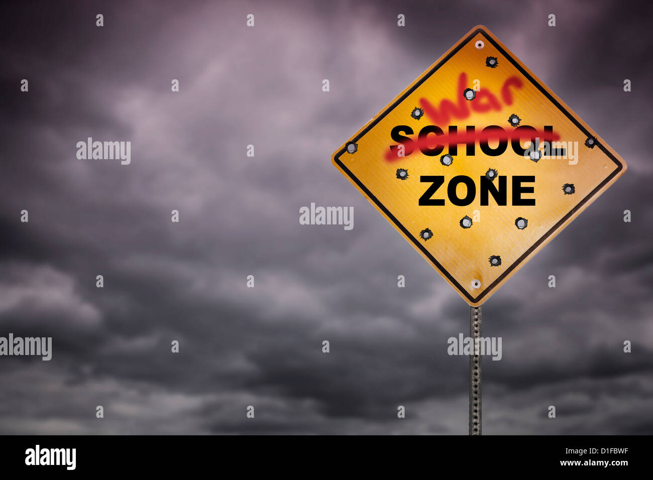 School zone sign with graffiti and bullet holes - Stock Image