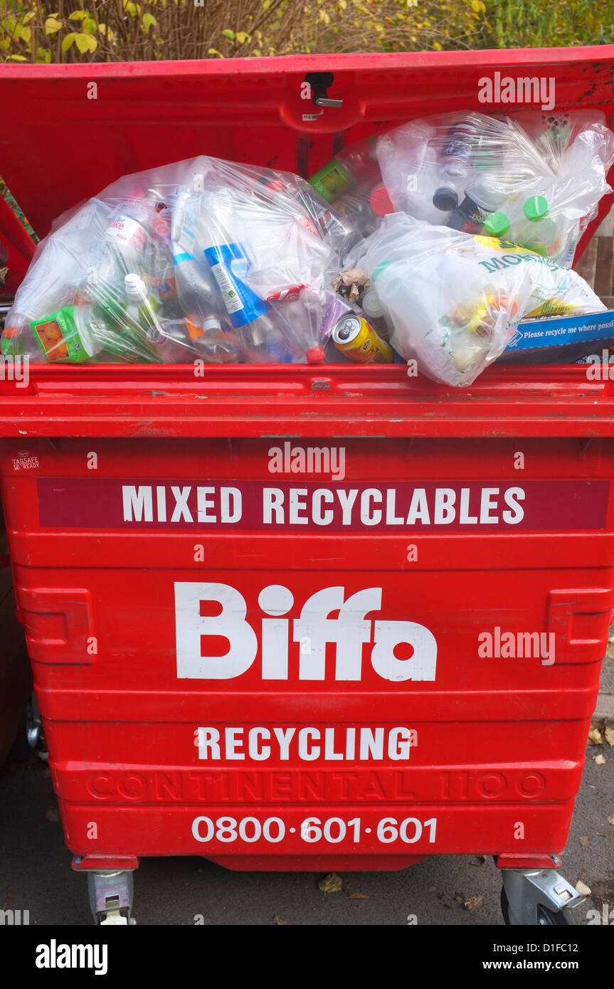 red Biffa recycling skips full of mixed recyclable materials UK - Stock Image