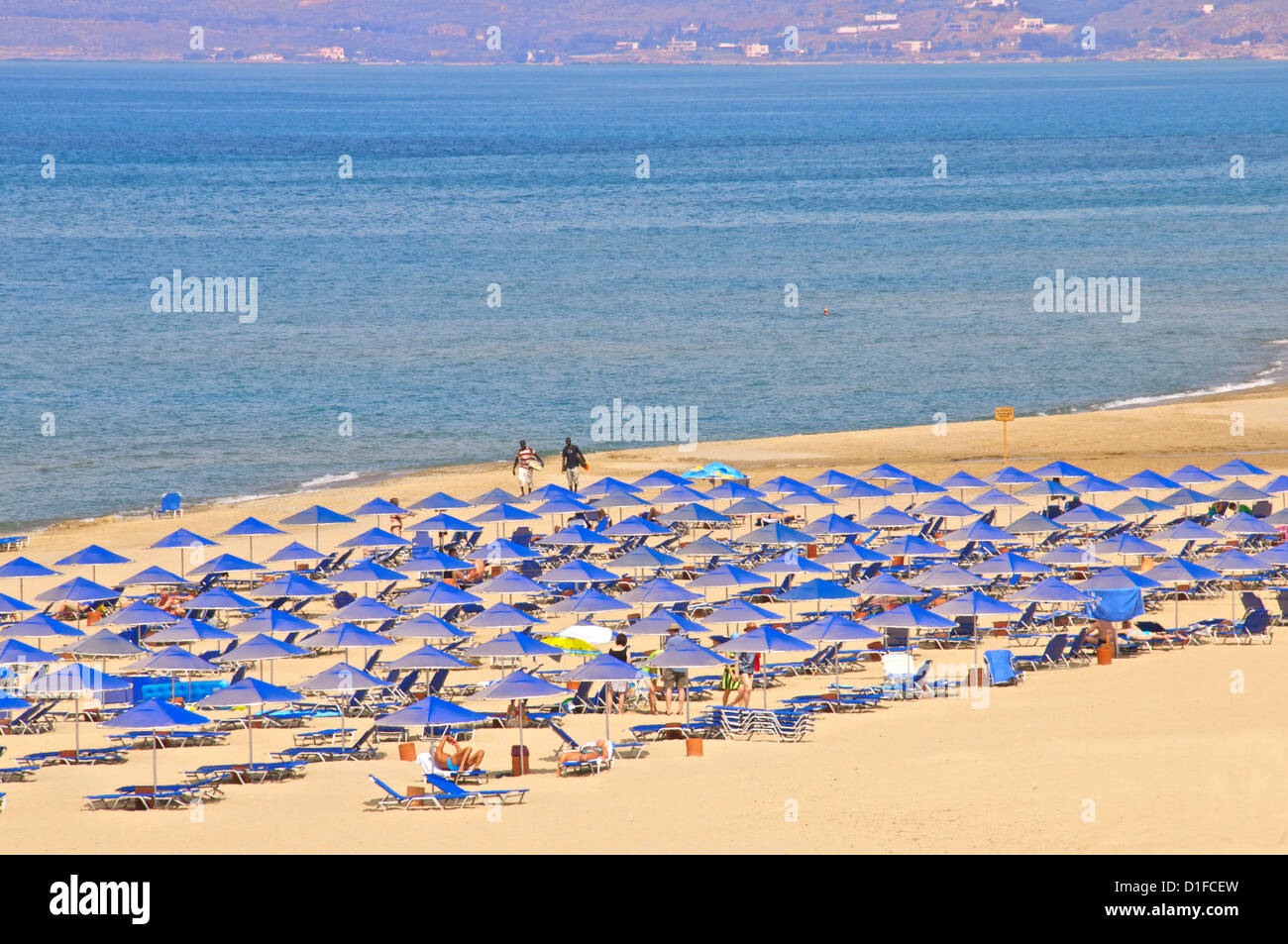 Beach and sunshades on beach at Giorgioupolis, Crete, Greek Islands, Greece, Europe - Stock Image