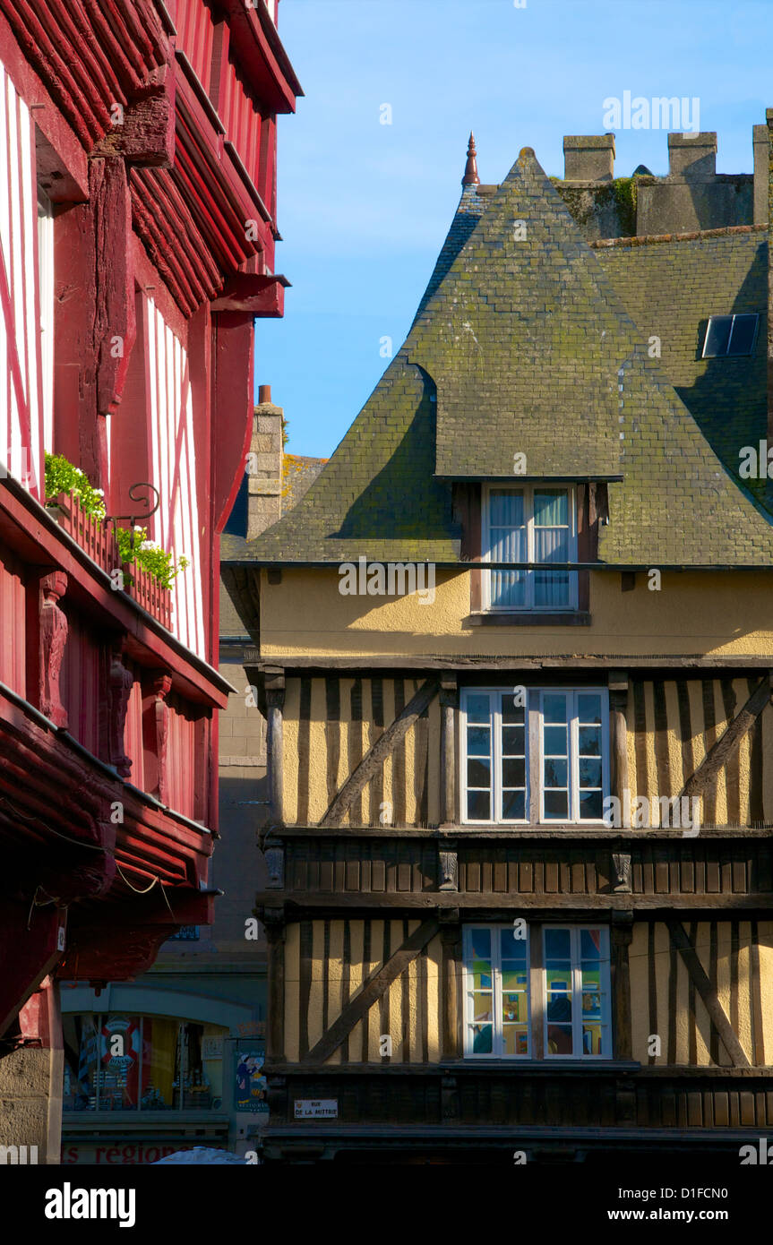 Medieval corbelled and half timbered mansions, in cobbled street, Old Town, Dinan, Brittany, Cotes d'Armor, - Stock Image