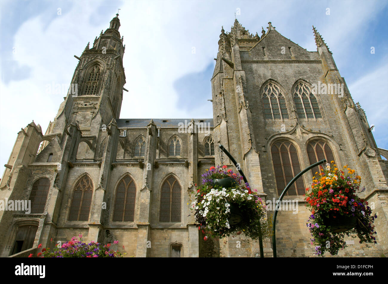 St. Peter church dating from the 15th century. with flowers, Coutances, Cotentin, Normandy, France, Europe - Stock Image
