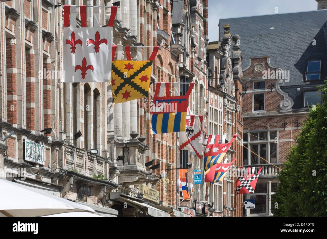 Heraldic banners decorate the Flemish gables in Leuven, Belgium, Europe - Stock Image