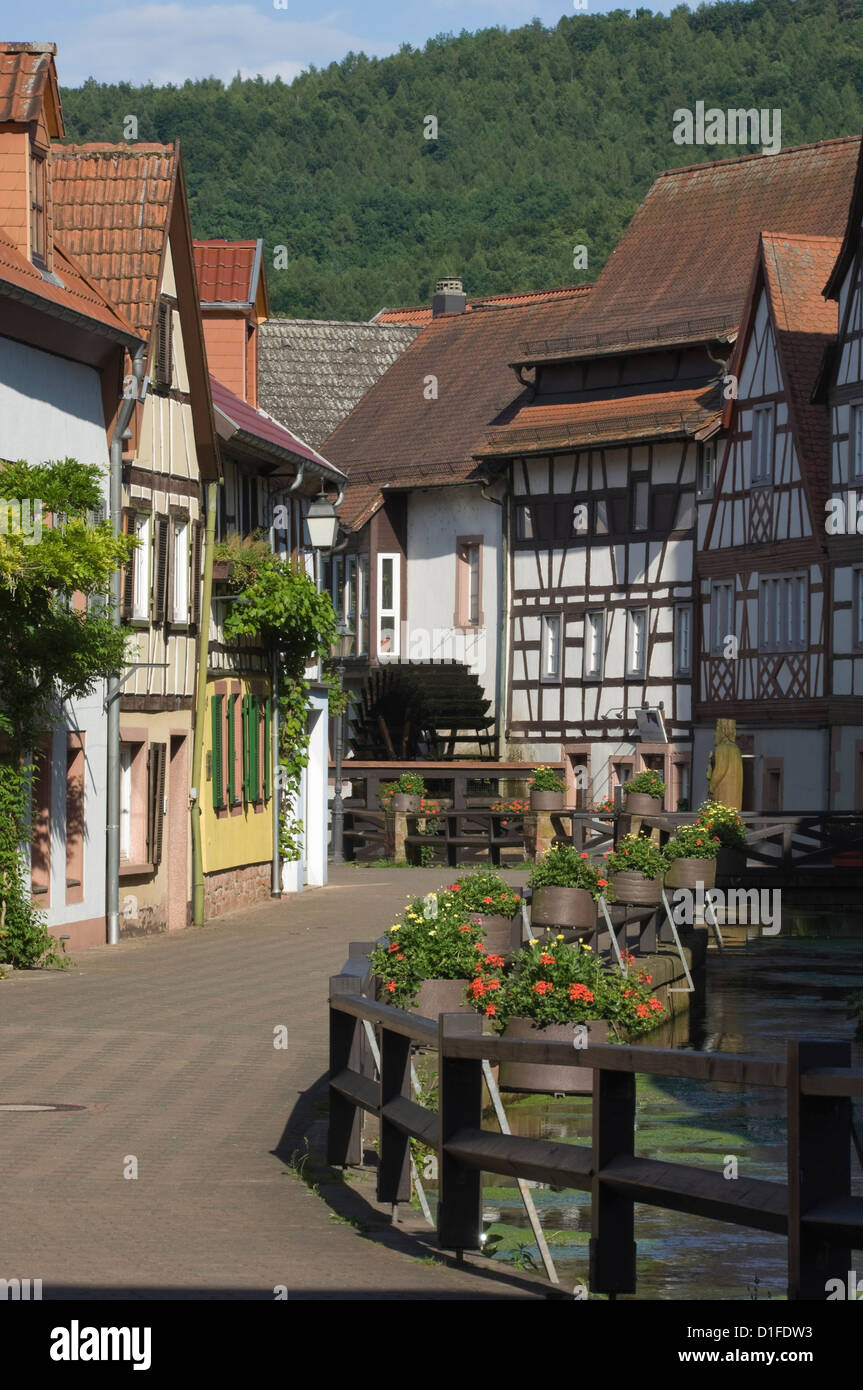 The Corn Mill Lane and mill wheel, Wassergasse, Annweiler am Trifels, Rhineland Palatinate, Germany, Europe - Stock Image