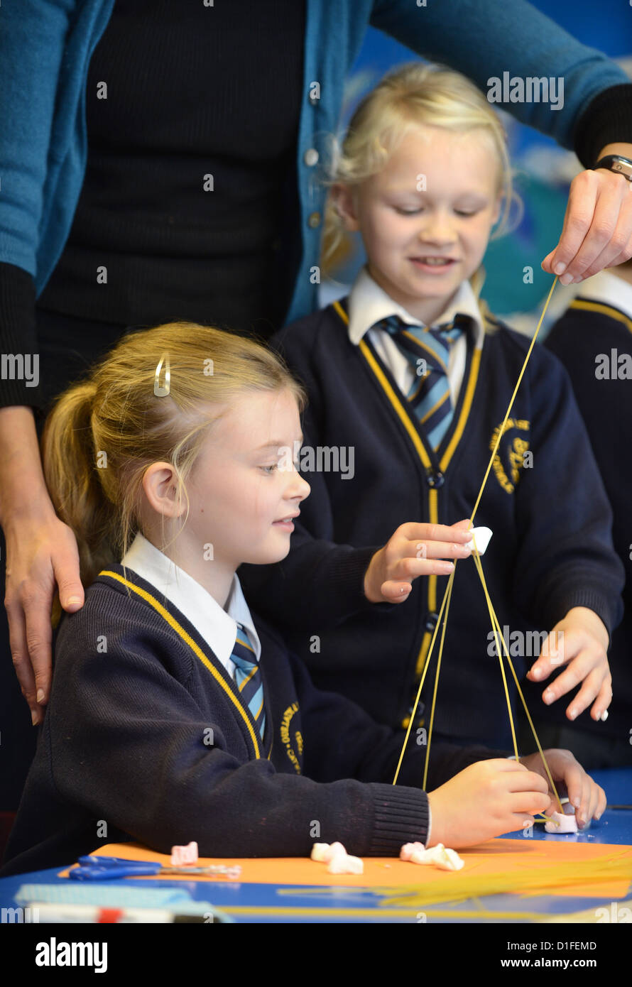 Schoolchildren making spaghetti towers at Our Lady & St. Werburgh's Catholic Primary School in Newcastle - Stock Image
