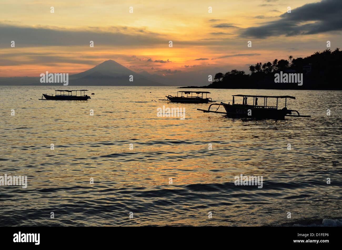 Sunset at Senggigi Beach, with Bali's Gunung Agung in the background, Senggigi, Lombok, Indonesia, Southeast - Stock Image