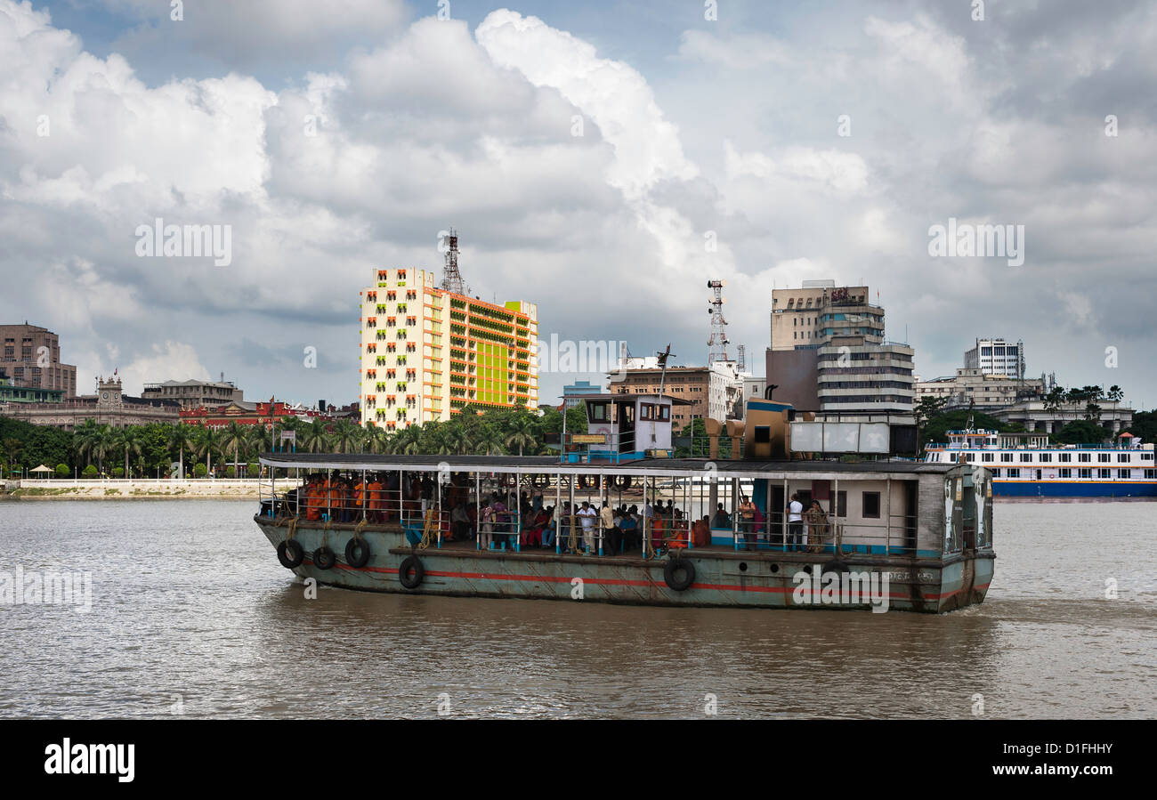 Ferry boat with passengers cross river Ganges at Kolkata, India on a bright sunny morning. - Stock Image
