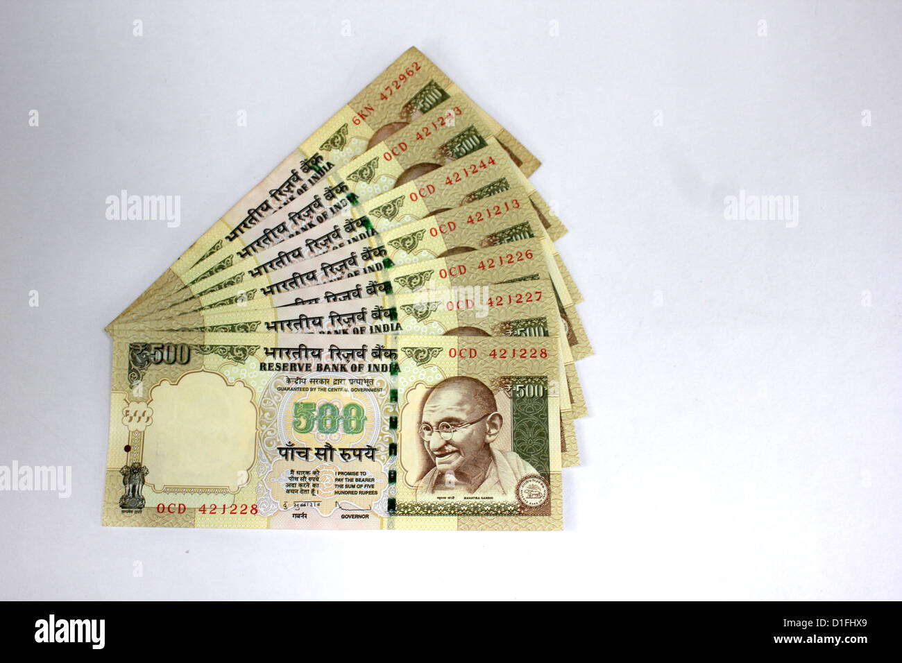 Indian currency A fan of five hundred rupee notes in white background 500 - Stock Image