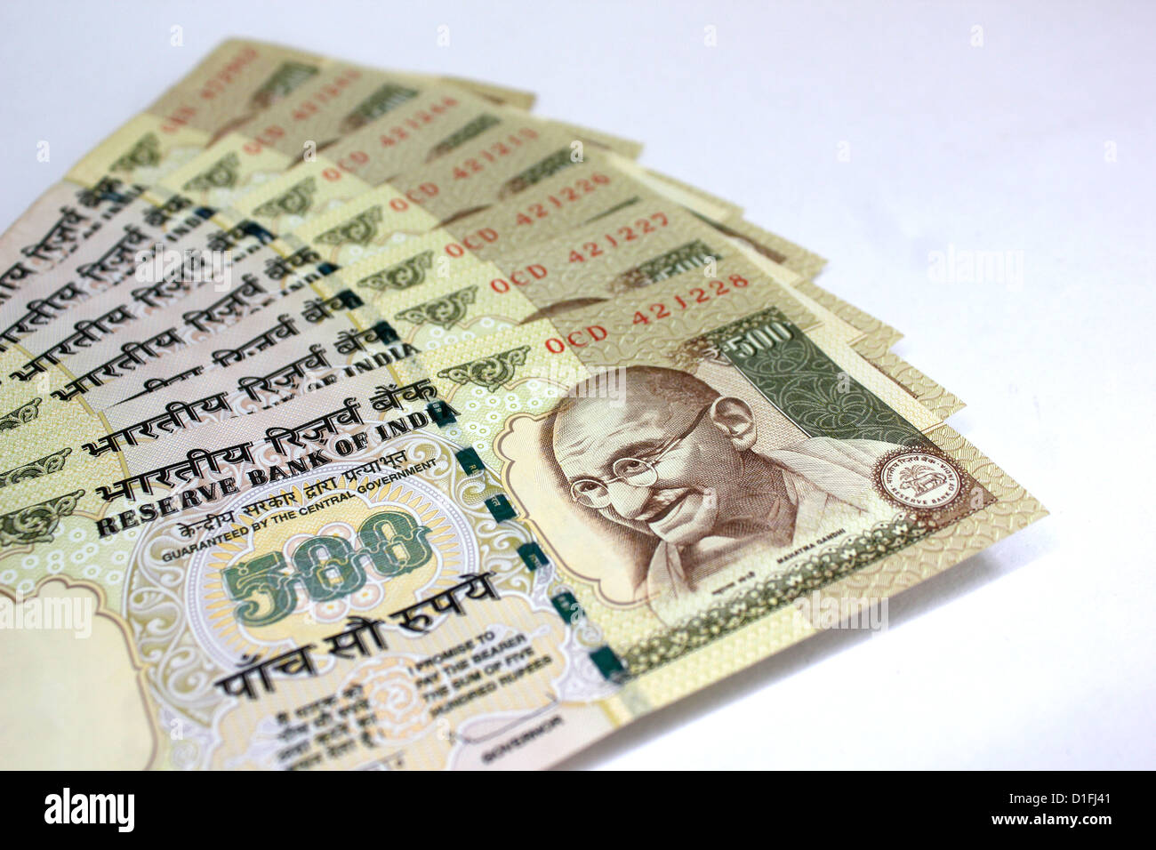 Indian currency A fan of 500 rupee notes in white background - Stock Image