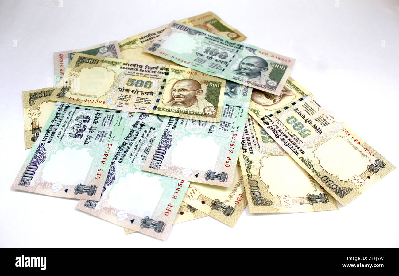 Indian currency  five hundred and one hundred rupee notes piled and mixed in white background 100 500 - Stock Image