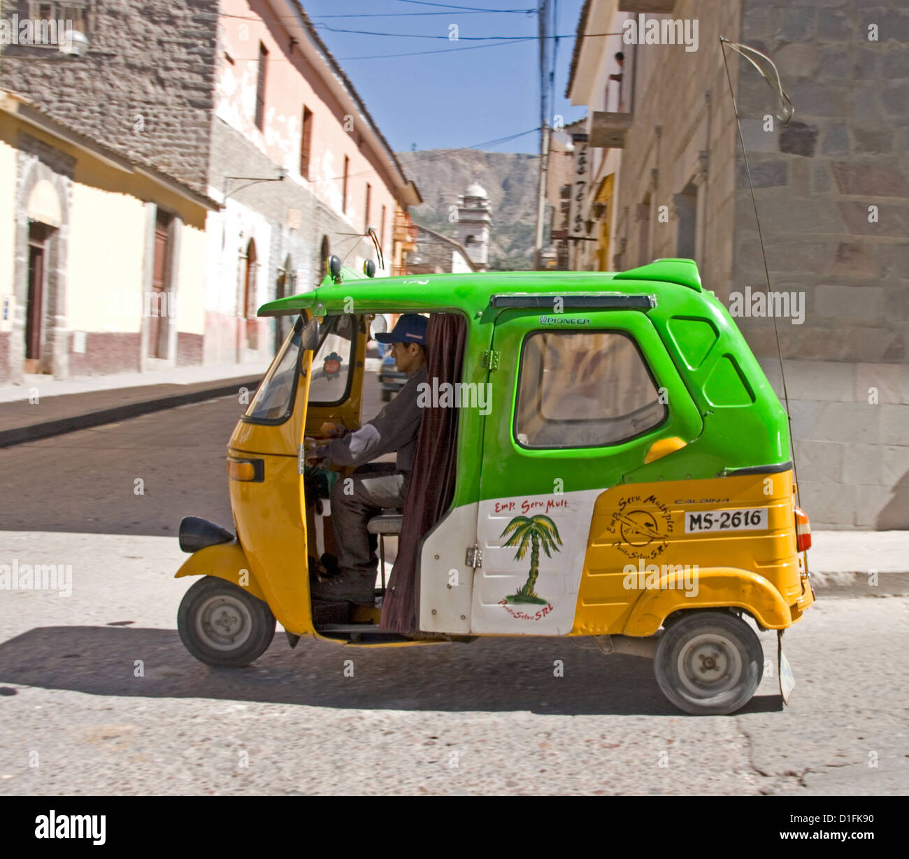 Unique transport - mototaxi in street of city of Ayacucho in the Andes  Mountains of Peru, South America