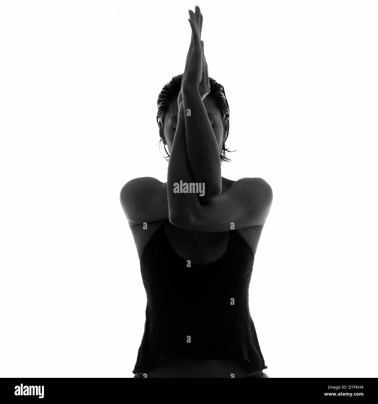 Woman in yoga pose - Stock Image
