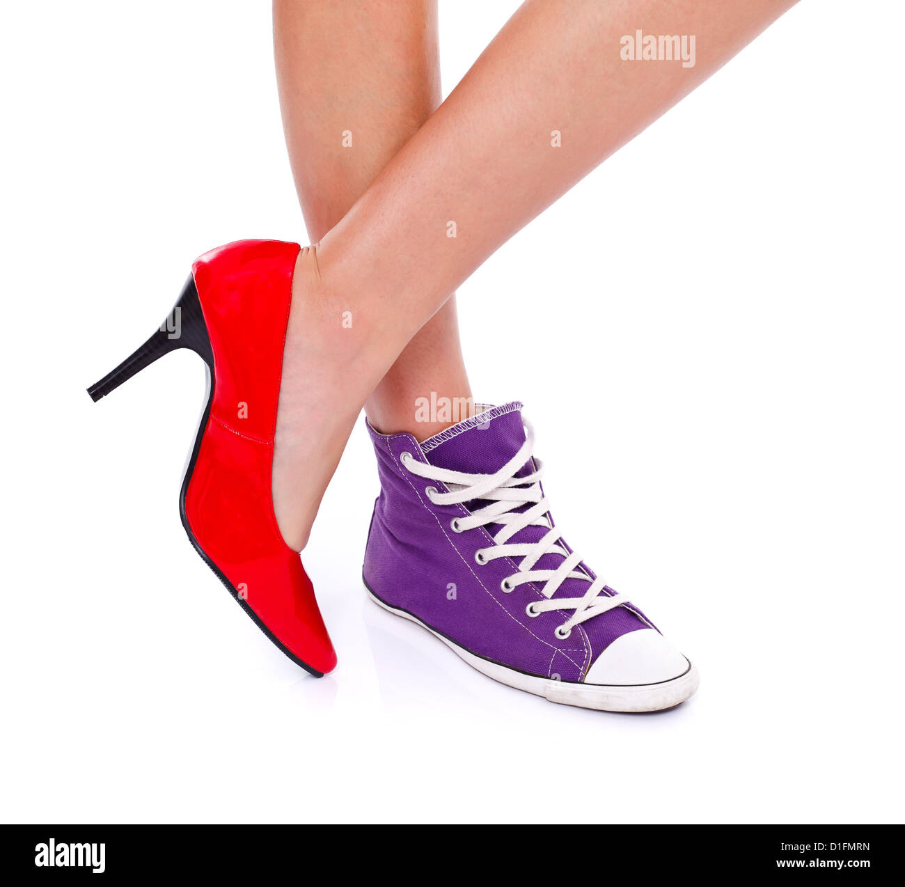 6462722c23b4 Woman wearing red high heel shoe on one leg and sport shoe on another leg