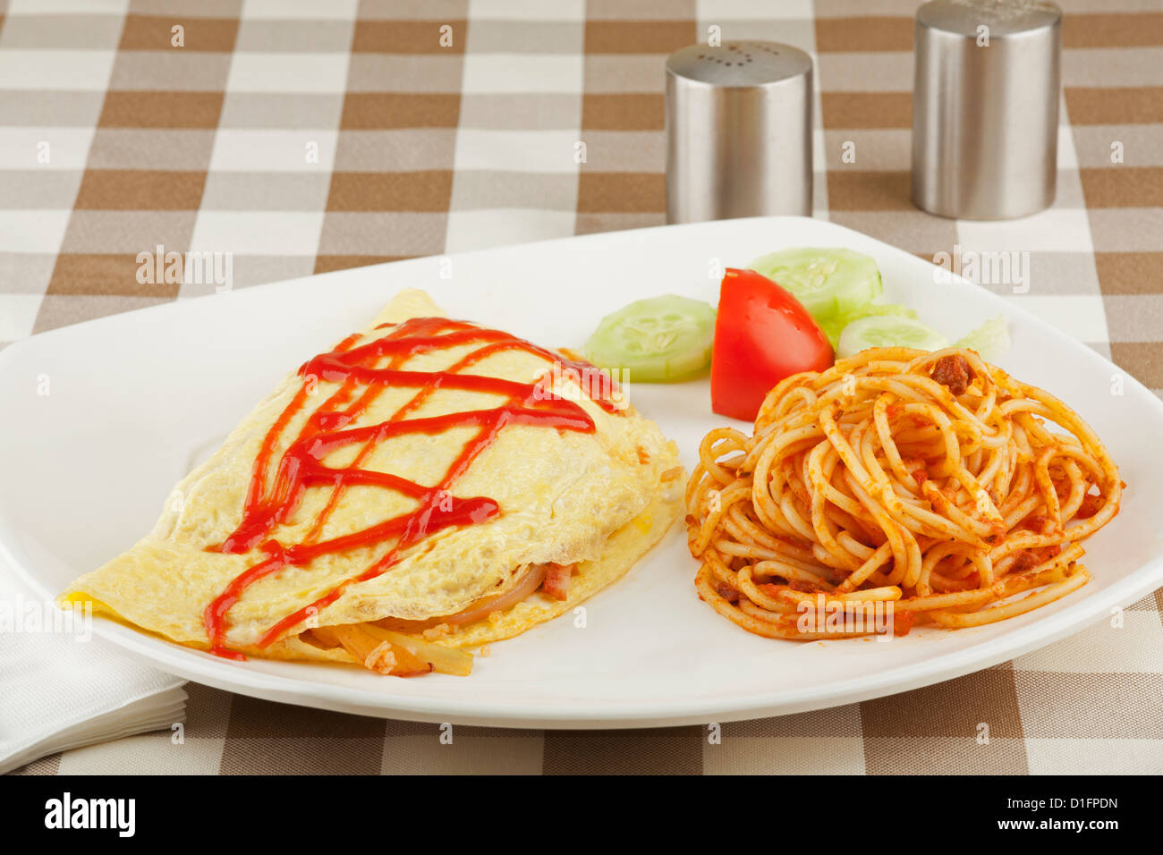 Vegetable egg omelet and pasta dish - Stock Image