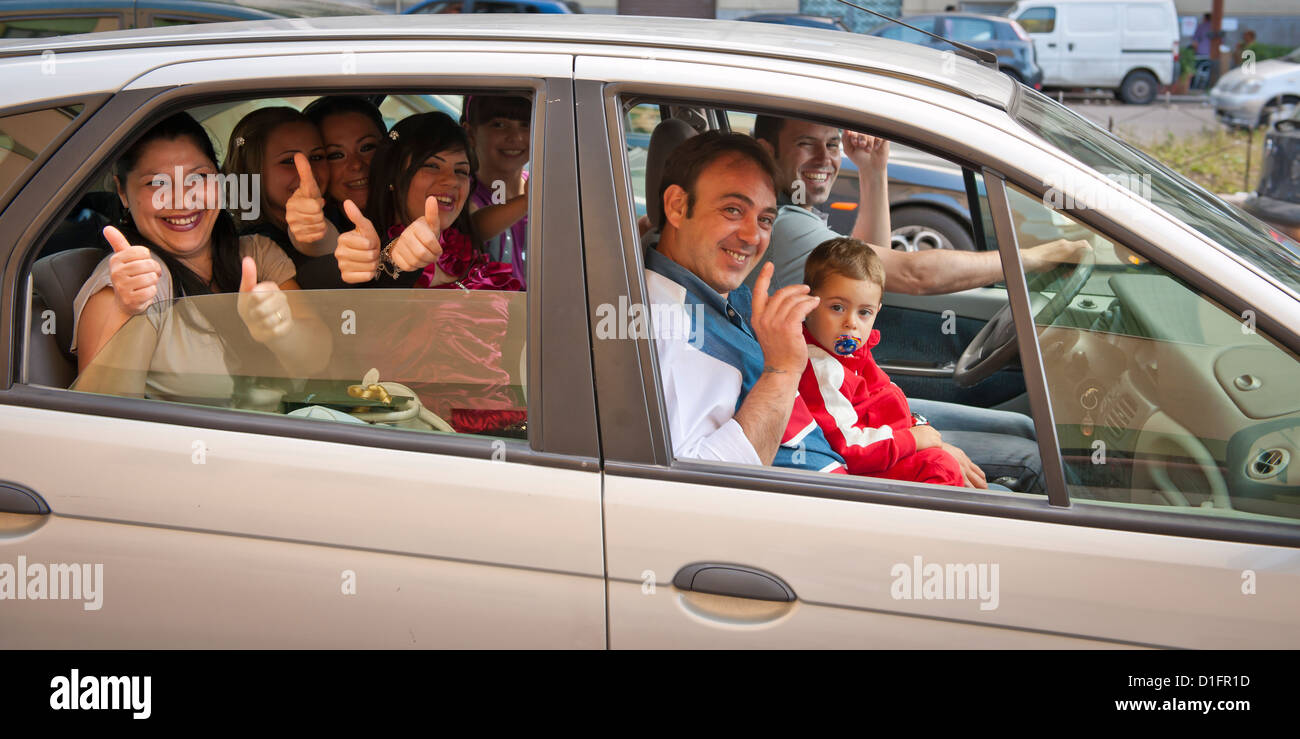 Car People: Happy Family Packed Into A Car In Palermo, Italy Stock