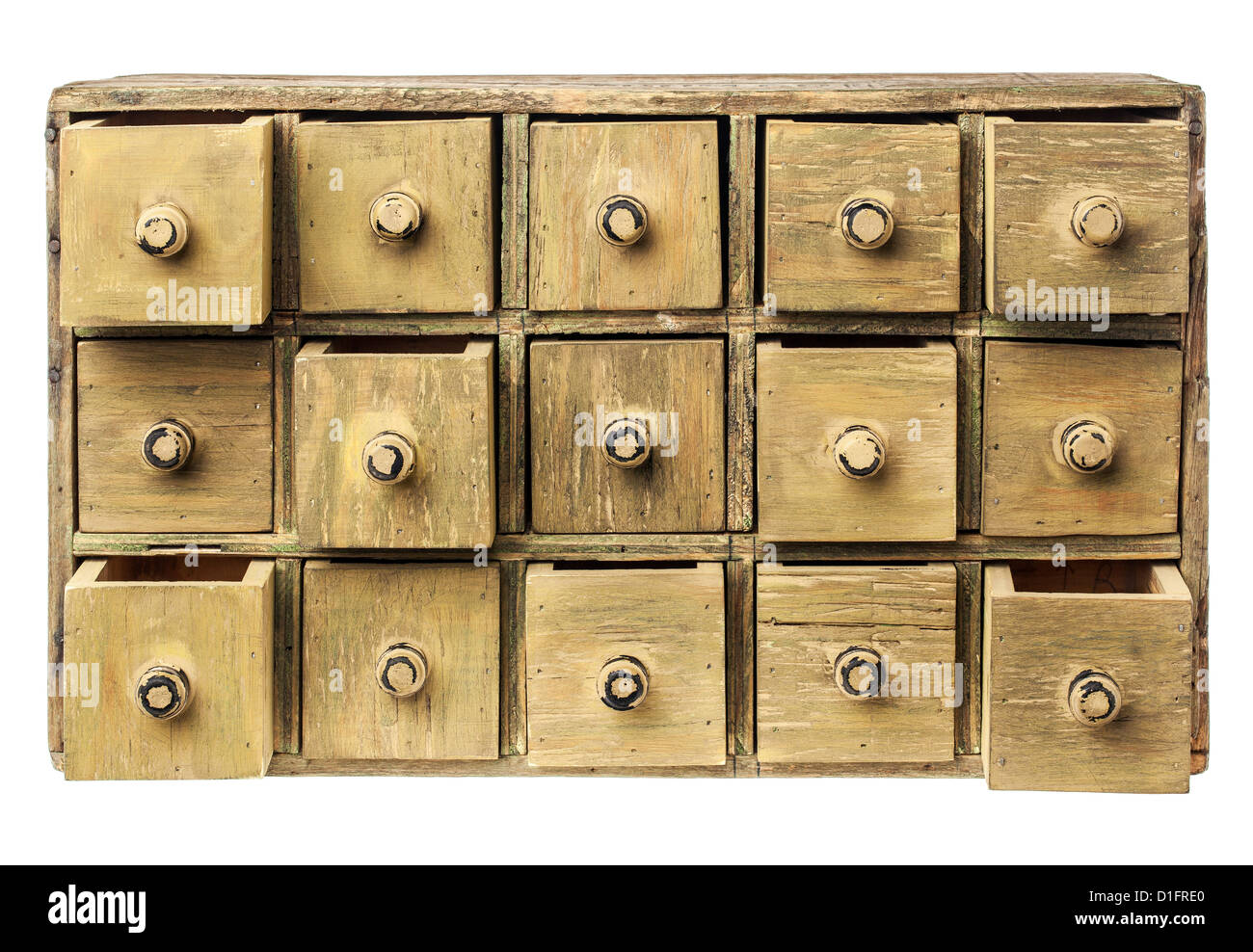 primitive wooden apothecary or catalog cabinet with partially open drawers - storage or sorting concept - Stock Image