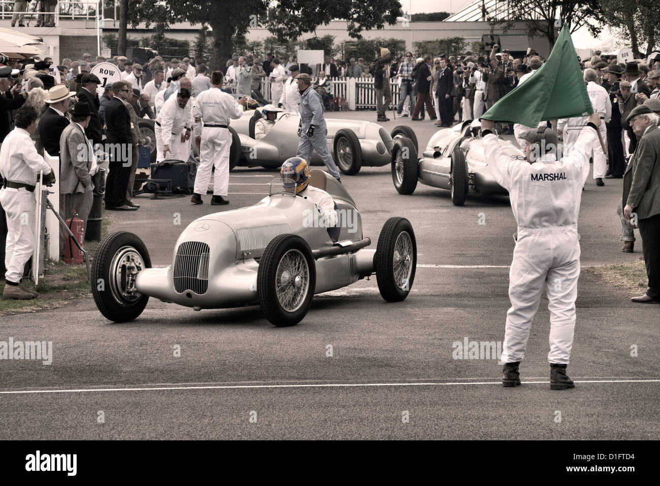 Silver Arrows demonstration run at Goodwood revival race meeting. GP cars leave holding area. - Stock Image