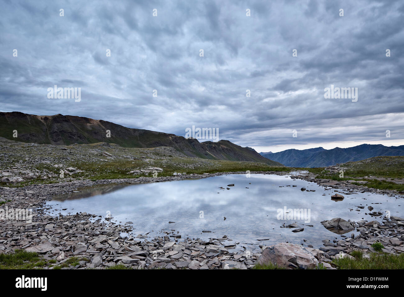 Clouds reflected in a tarn at Stony Pass, San Juan National Forest, Colorado, United States of America, North America - Stock Image