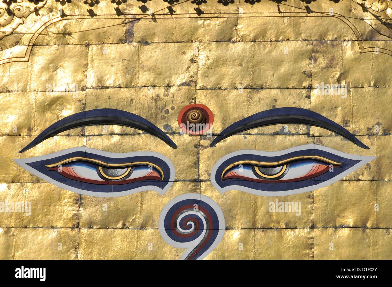 stupa eyes of buddha Swayambunath temple Kathmandu Nepal - Stock Image