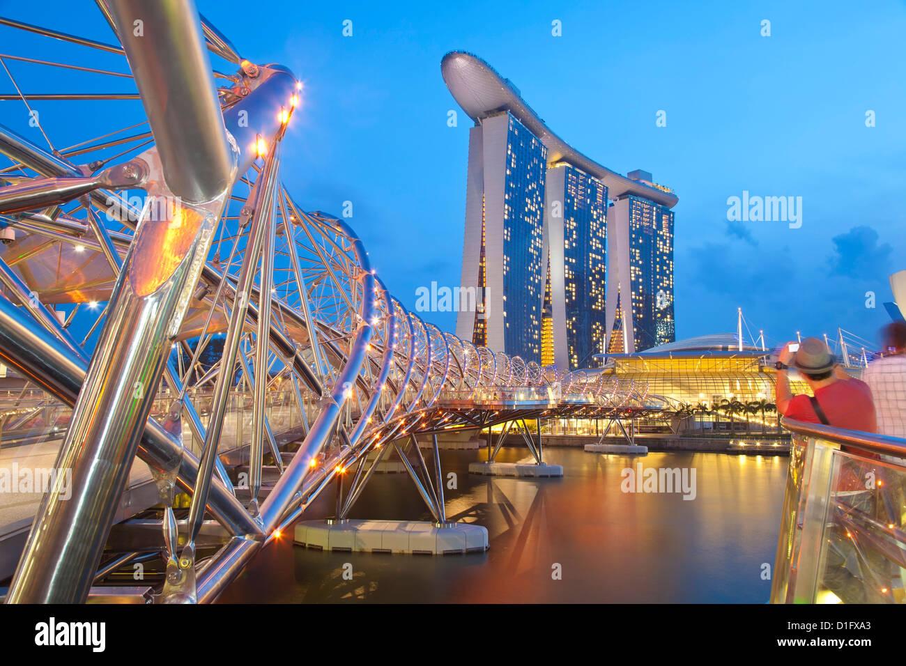 The Helix Bridge and Marina Bay Sands, Marina Bay, Singapore, Southeast Asia, Asia - Stock Image