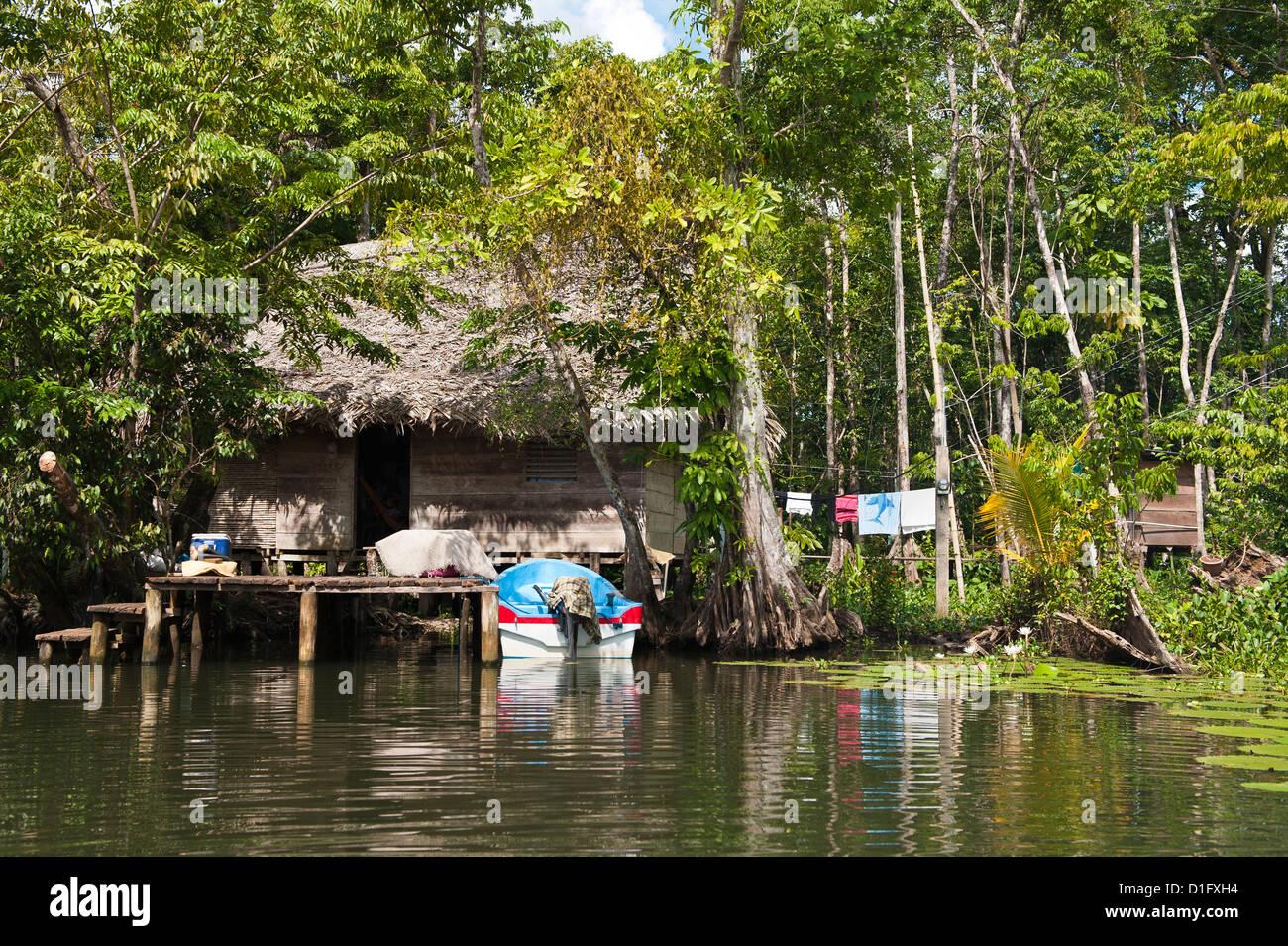 Indigenous people dwelling on Lake Izabal (Lago de Izabal), Guatemala, Central America - Stock Image