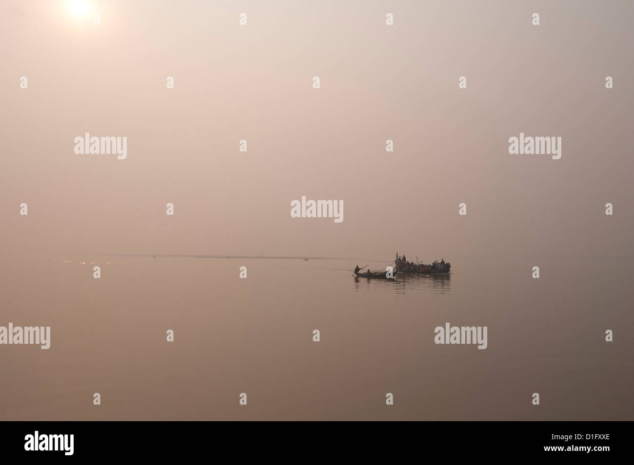Fishing boats and ferry on the River Ganges in the early morning, Sonepur, Bihar, India, Asia - Stock Image