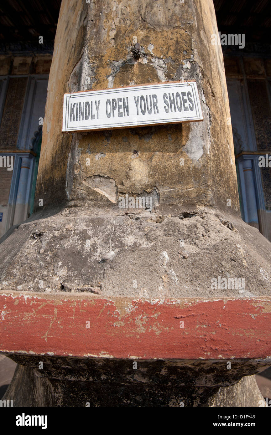Notice requesting visitors to remove their shoes, entrance to the Hugli Imambara, bank of the Hugli river, West - Stock Image