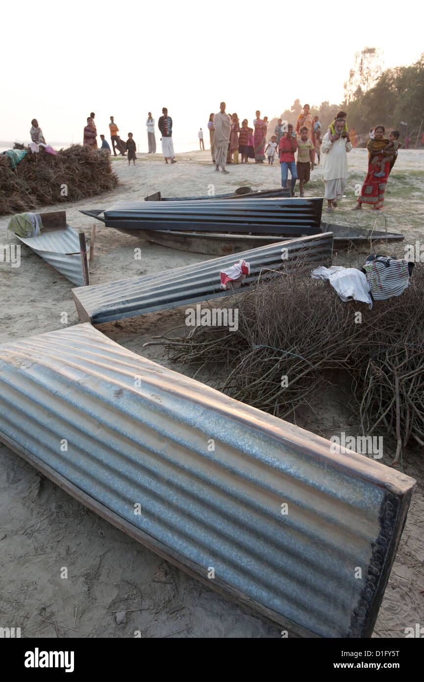Small boats made from sheets of corrugated iron, lying on the banks of the River Hugli (River Hooghly), West Bengal, - Stock Image
